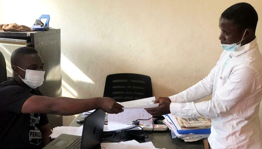 Umar Farouk receiving his birth certificate